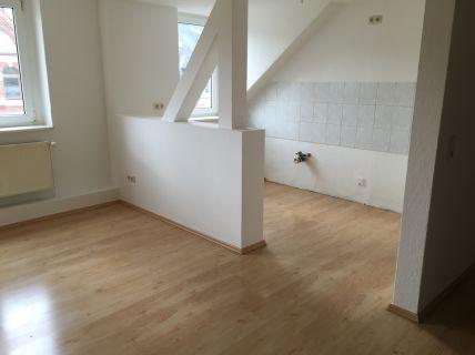 Gemütliche Dachgeschosswohnung mit zwei Zimmern und offener Küche