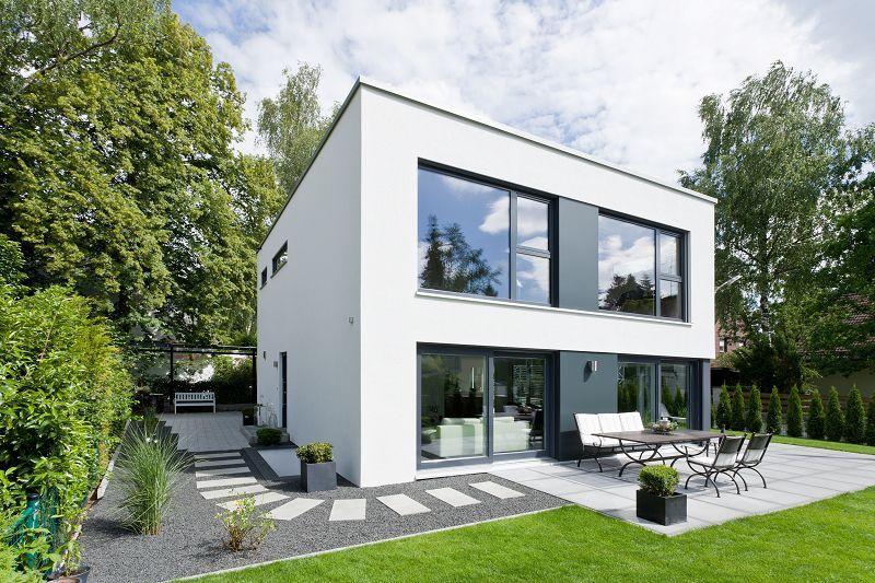 eleganter kubus gr nwald besticht mittels putz trespa fassade. Black Bedroom Furniture Sets. Home Design Ideas